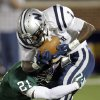 Edmond Santa Fe\'s Ryan Frazier (21) tackles Jarion Tudman (1) of Edmond North during a high school football game between Edmond Santa Fe and Edmond North at Wantland Stadium in Edmond, Okla., Friday, Oct. 28, 2011. Photo by Nate Billings, The Oklahoman