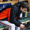 Photo - Baltimore Orioles pitcher Miguel Gonzalez sits in the dugout after being pulled in the fourth inning of a baseball game against the Detroit Tigers in Detroit, Friday, April 4, 2014. (AP Photo/Paul Sancya)
