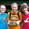Pictured from left: Kasey Mengwasser, Gina Mengwasser and Alex Crawford are showing off their turtle named Sweetheart, which they found at Camp DaKaNi last summer. Read more about Sweetheart and Camp Fire USA\'s Camp DaKaNi Day Camp in the attached article. Community Photo By: Cheryl Mengwasser Submitted By: Keri, Oklahoma City