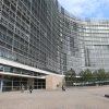 People walk along the European Commission headquarters, after the 2012 Nobel Peace Prize was awarded to the EU, at the European Commission headquarters in Brussels, Friday, Oct. 12, 2012. The European Union won the Nobel Peace Prize on Friday for its efforts to promote peace and democracy in Europe, despite being in the midst of its biggest crisis since the bloc was created in the 1950s. (AP Photo/Yves Logghe) ORG XMIT: YL116