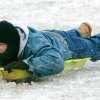 WINTER / COLD / WEATHER / ICE STORM / SLED / SLEDDING: 50-year-old Tony Banks slides down a hill at Will Rogers park in Oklahoma City , Okla. Dec. 10, 2007. BY STEVE GOOCH, THE OKLAHOMA. ORG XMIT: KOD