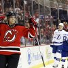 New Jersey Devils\' Adam Henrique reacts after scoring a goal against the Tampa Bay Lightning during the second period of an NHL hockey game, Thursday, Feb. 7, 2013, in Newark, N.J. (AP Photo/Julio Cortez)