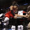 Rutgers\' Khadijah Rushdan gets a quick fix for her injured ankle in the first half of the NCAA women\'s basketball tournament game between Rutgers and Purdue at the Ford Center in Oklahoma City, Okla. on Sunday, March 29, 2009. She returned to action in the period. PHOTO BY STEVE SISNEY, THE OKLAHOMAN