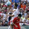 Photo - AS Roma midfielder Alessandro Florenzi (24) goes up for the ball against Liverpool FC midfielder Philippe Coutinho, below, during a friendly soccer match at Fenway Park in Boston, Wednesday, July 23, 2014. (AP Photo)