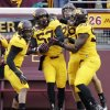Photo -   Minnesota linebacker Aaron Hill (57) celebrates his touchdown on an interception against Michigan State, with teammates Keanon Cooper (4) and Ben Perry (93) during the first half of an NCAA college football game, Saturday, Nov. 24, 2012, in Minneapolis. (AP Photo/Paul Battaglia)