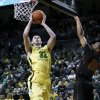 Photo - Oregon's Ben Carter, left, goes up for a basket against Southern California's Byron Wesley during the first half of an NCAA college basketball game in Eugene, Ore. on Saturday, Feb. 1, 2014. (AP Photo/Chris Pietsch)