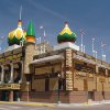 Photo - FILE - In this May 6, 2004, file photo is the Corn Palace blow in Mitchell, S.D., that is redecorated each year with corn cobs, grain and grasses. On Monday, July 15, 2013, the Mitchell City Council approved a $7.2 million upgrade to the quirky landmark dedicated to all things corn in an effort to draw in more visitors. The Corn Palace sees about 200,000 tourists each year.  (AP Photo/Doug Dreyer, File)