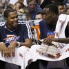 Photo - Oklahoma City Thunder's Kevin Durant, left, laughs as he talks with Kendrick Perkins during the second half in an NBA basketball game against the Phoenix Suns, Sunday, Feb. 10, 2013, in Phoenix. The Thunder won 97-69. (AP Photo/Ross D. Franklin) ORG XMIT: PNU113