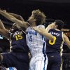 New Orleans Hornets center Robin Lopez (15) battles for a rebound with Utah Jazz forward Derrick Favors (15) and center Enes Kanter (0) in the first half of an NBA basketball game in New Orleans, Wednesday, Nov. 28, 2012. (AP Photo/Gerald Herbert)