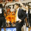 OSU head coach Travis Ford walks on the court during a timeout as Gonzaga\'s Sam Dower (35) and Kelly Olynyk (13) celebrate during a men\'s college basketball game between Oklahoma State University (OSU) and Gonzaga at Gallagher-Iba Arena in Stillwater, Okla., Monday, Dec. 31, 2012. Gonzaga won, 69-68. Photo by Nate Billings, The Oklahoman