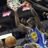 Golden State Warriors\' Harrison Barnes dunks in the second half of an NBA basketball game against the Minnesota Timberwolves, Friday, Nov. 16, 2012, in Minneapolis. The Warriors won 106-98. Barnes and David Lee each scored game highs of 18 points. (AP Photo/Jim Mone)