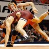 Oklahoma State's Joe Smith, back, and Oklahoma's Shayne Tucker wrestle at 157 pounds during the Bedlam dual on Friday night before an estimated 7,000 fans in Gallagher-Iba Arena. OSU won 26-11. (Photo by Nate Billings, The Oklahoman)