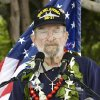 "Photo - Ed Vezey, of Moore, a survivor of the Dec. 7, 1941, attack on Pearl Harbor, speaks at a commemoration of the event in Hawaii. He wears a cross in memory of Francis ""Frank"" Flaherty, his bunkmate who was killed in the attack. PHOTO PROVIDED <strong></strong>"