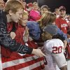 Quinton Carter (20) gets a hug from fans following the college football game between the University of Oklahoma Sooners (OU) and the Baylor Bears (BU) at Floyd Casey Stadium on Saturday, November 20, 2010, in Waco, Texas. Photo by Steve Sisney, The Oklahoman