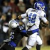 Deer Creek\'s Alec James gets by Guthrie\'s L\'Liott Curry during the high school football game between Guthrie and Deer Creek at Guthrie, Thursday, Oct. 18, 2012. Photo by Sarah Phipps, The Oklahoman