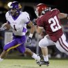 Anadarko\'s Sheldon Wilson gets by Tuttle\'s Toby Coats during the high school football game between Tuttle and Anadarko, Friday, Oct. 29, 2010, in Tuttle, Okla. Photo by Sarah Phipps, The Oklahoman