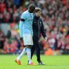 Photo - Manchester City's Yaya Toure, left, leaves the field after sustaining an injury during their English Premier League soccer match against Liverpool at Anfield in Liverpool, England, Sunday April. 13, 2014. (AP Photo/Clint Hughes)