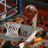 Oklahoma State\'s Markel Brown dunks over Alex Lundry during the college basketball game between Oklahoma State University and Ottawa(Kan.) at Gallagher-Iba Arena in Stillwater, Okla., Thursday, Nov. 1, 2012. (AP Photo/The Oklahoman, Sarah Phipps)