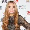 """In this May 9, 2012 photo shows actress Lindsay Lohan at the A&E Networks 2012 Upfront at Lincoln Center in New York. New York police were called to Lindsay Lohan\'s childhood home in suburban New York after a report of a fight between the troubled actress and her mother. Nassau County police say officers were called around 8 a.m. Wednesday, Oct. 10, to the Merrick, Long Island, home where the starlet grew up. Her mother Dina lives in the home with some of her other children. An investigation revealed """"no criminality."""" Police did not release details on the subject of the argument. (AP Photo/Starpix, Kristina Bumphrey, file)"""