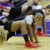 Photo - Cal State Northridge guard Breeyon Alexander, center, stretches with teammates during practice at the NCAA women's college basketball tournament, Saturday, March 22, 2014, in Seattle. Cal State Northridge plays South Carolina in a first-round game on Sunday. (AP Photo/Ted S. Warren)