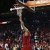 Miami Heat\'s LeBron James hangs onto the net during the final minute of an NBA basketball game against the Oklahoma City Thunder in Miami, Tuesday, Dec. 25, 2012. The Heat won 103-97. (AP Photo/J Pat Carter)