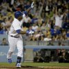 Photo - Los Angeles Dodgers' Juan Uribe celebrates his game tying home run against the Arizona Diamondbacks during the ninth inning of a baseball game in Los Angeles, Friday, April 18, 2014. (AP Photo/Chris Carlson)