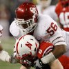 OU\'s Ronnell Lewis brings down Nebraska\'s Tim Marlowe during the Big 12 football championship game between the University of Oklahoma Sooners (OU) and the University of Nebraska Cornhuskers (NU) at Cowboys Stadium on Saturday, Dec. 4, 2010, in Arlington, Texas. Photo by Bryan Terry, The Oklahoman