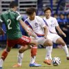 Photo - Mexico defender Francisco Javier Rodriguez (2) competes for the ball with South Korea midfielders Yeom Ki-Hun (7) and Lee Myung-Joo during the first half of an international friendly soccer match on Wednesday, Jan. 29, 2014, in San Antonio. (AP Photo/Darren Abate)