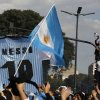 Soccer fans gather at the obelisk to welcome home Argentina\'s soccer team, before it was announced that the team won\'t be coming to this landmark for a welcome ceremony after they landed at the airport in Buenos Aires, Argentina, Monday, July 14, 2014. Fans came out to welcome home Argentina\'s team after it was defeated 1-0 by Germany at the Brazil World Cup final match on Sunday. (AP Photo/Jorge Saenz)