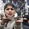 A Syrian boy holds a bird in his hand that he said was injured in a government airstrike hit the neighborhood of Ansari, in Aleppo, Syria, Sunday, Feb. 3, 2013. The Britain-based activist group Syrian Observatory for Human Rights, which opposes the regime, said government troops bombarded a building in Aleppo\'s rebel-held neighborhood of Eastern Ansari that killed over 10 people, including at least five children. (AP Photo/Abdullah al-Yassin)
