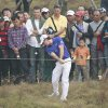 Photo -   Rory McIlroy of Northern Ireland hits a shot from the rough on the 6th green during the final round of the Masters golf tournament in Shanghai, China on Sunday Oct. 28, 2012. (AP Photo/Eugene Hoshiko)