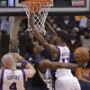 Memphis Grizzlies\' Tony Allen, center, scores under pressure from Phoenix Suns\' Marcin Gortat, of Poland, 94) and Markieff Morris (11) during the second half of an NBA basketball game on Wednesday, Dec. 12, 2012, in Phoenix. (AP Photo/Matt York)