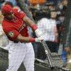 Outfielder Yoenis Cespedes, of the Oakland Athletics, hits during batting practice for the MLB All-Star baseball game, Monday, July 14, 2014, in Minneapolis. (AP Photo/Jeff Roberson)
