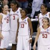 OU\'s Whitney Hand, left, talks with Courtney Paris next to Danielle Robinson, Ashley Paris and Jenny Vining near the end of their win in the NCAA women\'s basketball tournament game between Oklahoma and Pittsburgh at the Ford Center in Oklahoma City, Sunday, March 29, 2009. PHOTO BY BRYAN TERRY, THE OKLAHOMAN