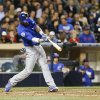 Photo - Chicago Cubs' Junior Lake hits an RBI double to deep center field against the San Diego Padres in the fifth inning of a baseball game Thursday, May 22, 2014, in San Diego.  (AP Photo/Lenny Ignelzi)