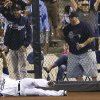 Photo - San Diego Padres right fielder Rymer Liriano holds up the ball in his glove after making a leaping catch at the wall for the out on Los Angeles Dodgers' Dee Gordon during the fifth inning in a baseball game Friday, Aug. 29, 2014, in San Diego. (AP Photo/Gregory Bull)