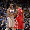 Oklahoma City\'s Russell Westbrook (0) is held back by Houston\'s Courtney Lee (5) after he is called for a technical during the NBA basketball game between the Oklahoma City Thunder and the Houston Rockets at the Chesapeake Energy Arena, Tuesday, March 13, 2012. Photo by Sarah Phipps, The Oklahoman.