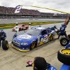 Brad Keselowski\'s crew works to service his car during the NASCAR Sprint Cup Series auto race at Talladega Superspeedway in Talladega, Ala., Sunday, Oct. 7, 2012. (AP Photo/Rainier Ehrhardt)