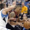 Portland Trail Blazers\' Damian Lillard drives to the basket against Minnesota Timberwolves\' J.J. Barea (11) during the fourth quarter of an NBA basketball game Monday, Feb. 4, 2013, in Minneapolis. The Trail Blazers won 100-98. (AP Photo/Hannah Foslien)