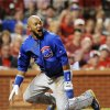 Photo - Chicago Cubs' Emilio Bonifacio reacts after being called out at the plate against the St. Louis Cardinals in the fourth inning in a baseball game, Monday, May 12, 2014, at Busch Stadium in St. Louis. The call was reversed after a challenge review. (AP Photo/Bill Boyce)
