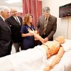 Photo - Respiratory therapy student Megan Johnson  demonstrates proper care on a patient dummy to dedication guests, from left, Rose State Regent Dick Hefton, Midwest City Mayor Russell Smith and state Rep. Gary Banz.