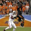 Oklahoma State cornerback Justin Gilbert (4) intercepts a pass intended for Stanford tight end Coby Fleener (82) during the first half of the Fiesta Bowl NCAA college football game on Monday, Jan. 2, 2012, in Glendale, Ariz. (AP Photo/Ross D. Franklin)