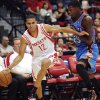 Photo - Houston Rockets' Kevin Martingets (12) dribbles past Oklahoma City Thunder's DeAndre Liggins during the second quarter of an NBA preseason basketball game in Hidalgo, Texas, Wednesday, Oct. 10, 2012. (AP Photo/Delcia Lopez) ORG XMIT: TXDL111