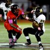 Midwest City\'s Tre\'jon Sherffield (28) tries to get past Del City\'s Xaviar Sanders in high school football on Friday, Sept. 20, 2013 in Del City, Okla. Photo by Steve Sisney, The Oklahoman