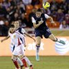 United States\' Abby Wambach (14) heads a ball in front of China\'s Huang Yini during the second half of an exhibition soccer match, Wednesday, Dec. 12, 2012, in Houston. (AP Photo/David J. Phillip)
