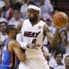 Miami Heat small forward LeBron James (6) looks to pass against Oklahoma City Thunder point guard Russell Westbrook (0) during the second half at Game 3 of the NBA Finals basketball series, Sunday, June 17, 2012, in Miami. (AP Photo/Lynne Sladky) ORG XMIT: NBA145