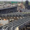 FILE - This May 17, 2012 file photo show the steel skeleton for the eastern end of the new Innerbelt Bridge in Cleveland sits next to the existing span. Much of America's infrastructure, including its interstate highway system, is more than half a century old and in need of serious work to keep pace with a rising population. Highway, rail and airport bottlenecks slow the movement of goods and commuters, costing billions in wasted time and fuel and even measurably slowing the economy. (AP Photo/Mark Duncan, File)