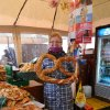 Photo -  A vendor in the Salzburg, Austria, food market offers a pretzel. Photo courtesy of John Blanchette.