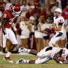 Oklahoma\'s Gabe Lynn (9) hits Ball State\'s Jahwan Edwards (38) during the college football game between the University of Oklahoma Sooners (OU) and the Ball State Cardinals at Gaylord Family-Oklahoma Memorial Stadium on Saturday, Oct. 01, 2011, in Norman, Okla. Oklahoma won 62-6. Photo by Bryan Terry, The Oklahoman ORG XMIT: KOD