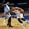 Oklahoma City\'s Thabo Sefolosha (25) drives against Denver\'s Ty Lawson (3) during an NBA basketball game between the Oklahoma City Thunder and the Denver Nuggets at Chesapeake Energy Arena in Oklahoma City, Monday, Nov. 18, 2013. Photo by Nate Billings, The Oklahoman